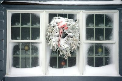 A Window at Maine's Nubble Lighthouse Is Festively Decorated for Winter