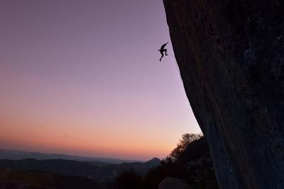 A Rock Climber Falls from the Side of Ceuse at Sunset