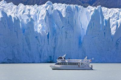 Tourist in a Boat Close to Perito Moreno Glacier Hope to Witness Calving