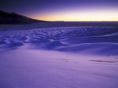 A Rarely Seen View of Snow-Covered Sand Dunes, at Twilight