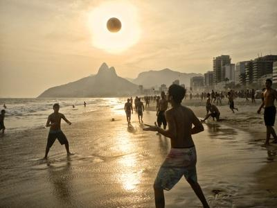Young Men Play Beach Football on Ipanema Beach as the Sun Sets