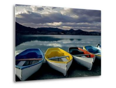 Boats on the Shore of Lake Banyoles at Sunset