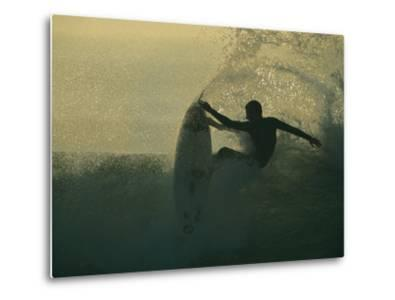 In a Spray of Surf, a Surfer Leaps Up on a Breaking Wave