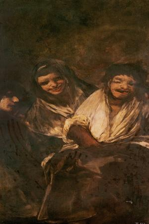 A Man and Two Women Laughing