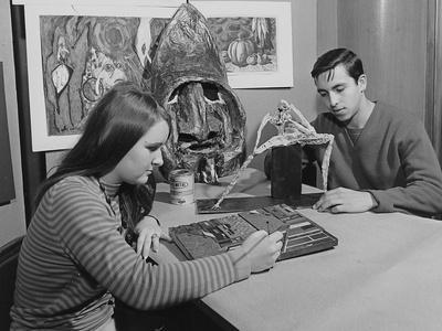A Young Woman Works on a Painting While a Young Man Works on a Sculpture
