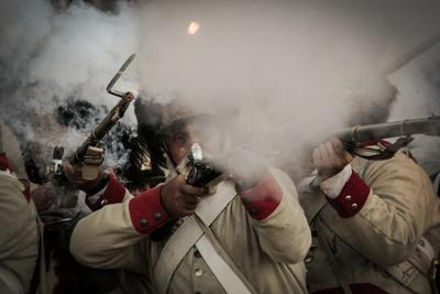Historical Reenactment: Austrian Imperial Soldiers Armed with Muzzle-Loading Guns Firing on Napoleo