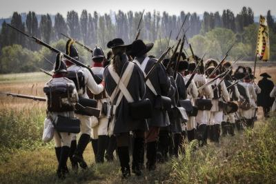 Historical Reenactment: Austrian Imperial Soldiers Marching in the Venetian Countryside