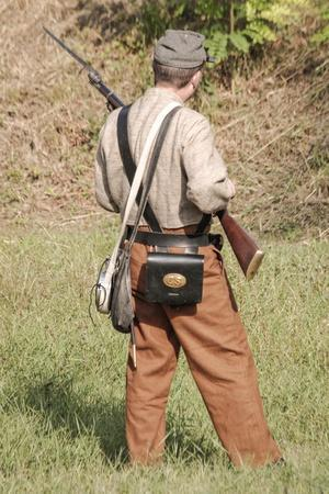 Historical Reenactment: Confederate (Southern) Soldier with Muzzle-Loading Percussion Rifle
