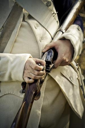 Historical Reenactment: Soldier from Newly Created American Army Attaching Flint of His Muzzle-Load