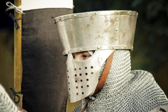 Historical Reenactment: Man-At-Arms Wearing Great Helm with Aventail  (Curtain of Chain Mail)