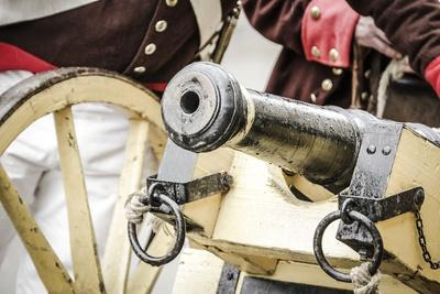 Historical Reenactment: Muzzle-Loading Cannon Used by Austrian Imperial Army. Napoleonic Wars