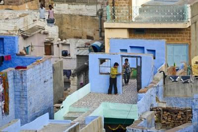 Two Boys Playing 'Cops and Robbers' (Sequence: 1 of 4) on Rooftops of Old 'Blue City'
