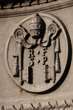 Emblem of Reverend Fabric of Saint Peter (Fabbrica Di San Pietro). St. Peter's Square. Vatican City