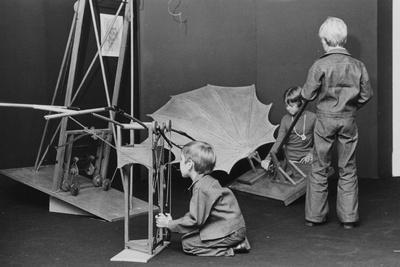 A Group of Children Get a Close Look at Models of Flying Machines Designed by Leonardo Da Vinci