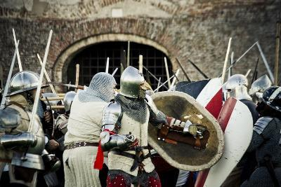 Historical Reenactment: Fighting Between Armour-Clad Soldiers with Shields, 14th Century