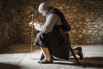 Historical Reenactment: Templar Knight Praying before Entering Battle, 13th-14th Century