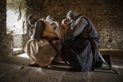 Historical Reenactment: Templar Knight Praying before Entering Battle, 13th-14th Century