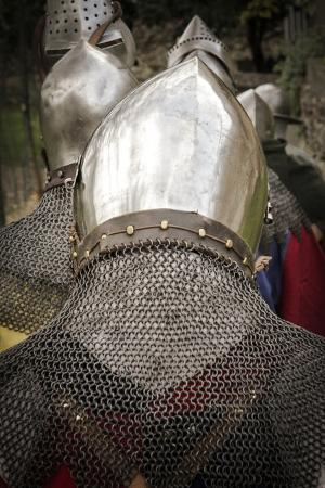 Historical Reenactment: Column of Soldiers Wearing Helmets and Chain Mail Gorgets, 14th Century