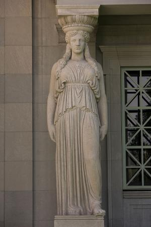 One of the Caryatid on the Façade of the Museum of Science and Industry at Sunset