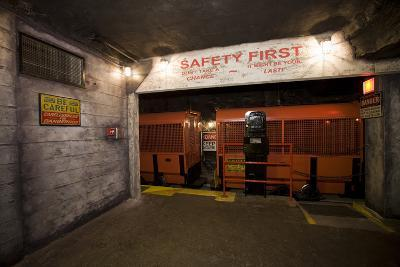 A Coal Mine Train and Boarding Platform with Multiple Safety Notices Posted around It