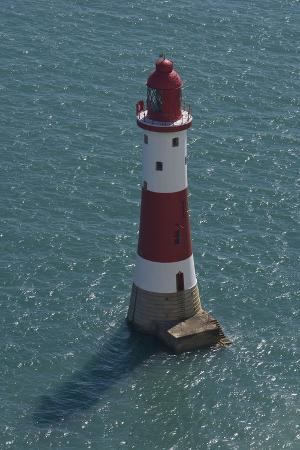 Lighthouse in Sea Below Beachy Head on English Channel, East Sussex, United Kingdom