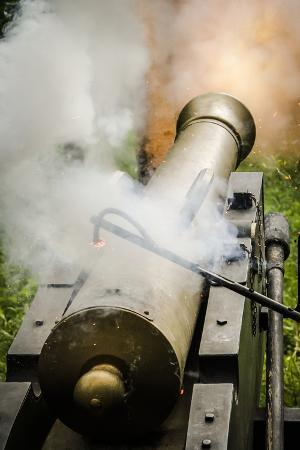 Historical Reenactment: French Muzzle-Loading Cannon. Napoleonic Wars, End of 18th Century