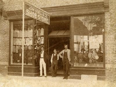 Store Personnel in Front of John Sewell and Co. Shoe Store, C.1910