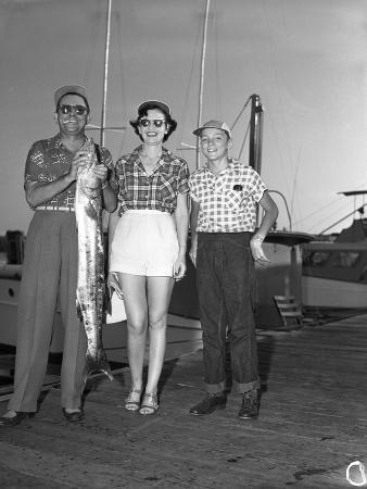 A Family Shows Off their Catch from a Deep Sea Fishing Trip, 1950