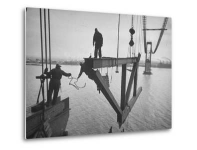 Raising the Truss, Men of the Raising Gang Ride the Swinging Steel 160 Feet Above the Water