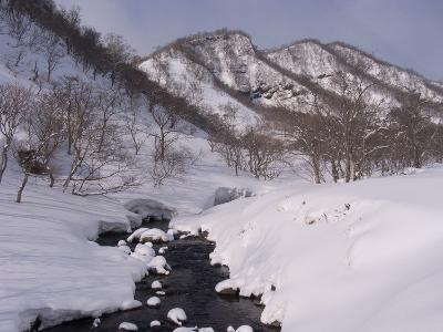 Winter Landscape with a Stream and Mountains