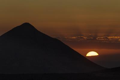 The Setting Sun, with Green Flash Forming, Next to Monta a De Tindaya, a Sacred Mountain