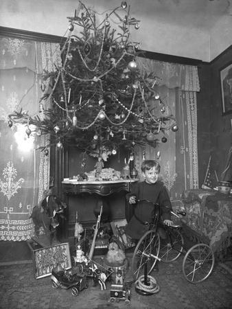 Seymour Boy Posed with Tricycle Beside Christmas Tree in Parlor, Christmas 1912