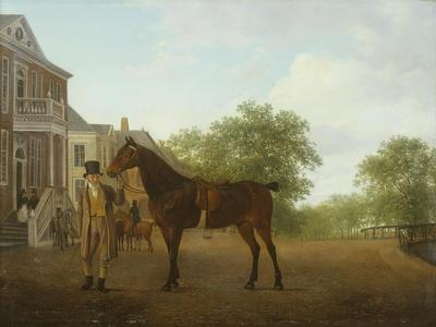 A Gentleman Holding a Saddled Horse in a Street by a Canal
