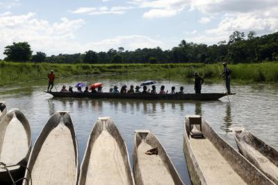 A Popular Activity in Chitwan National Park Is Getting a Ride in a Traditional Dugout Canoe
