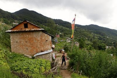 A Man Walks Through the Small Village of Tarebir, About an Hour Walk Up from Kathmandu