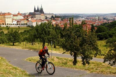 A Boy Rides His Bike Up Petrin Hill