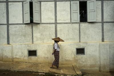A Woman Walks Past a Meditation Center