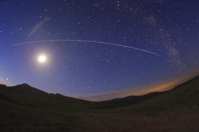 The International Space Station Crossing the Sky at Break of Dawn