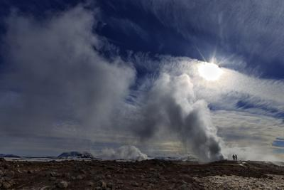 Steam from Geysers in Myvatn Geothermal Area, Northern Iceland. a Volcano Is on the Horizon