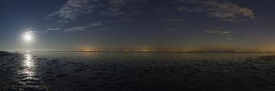 The Moon Rises over a Bay on the Caspian Sea. Constellations Orion and Canis Major, on the Right