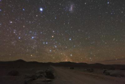 The Large Magellanic Cloud and Bright Star Canopus in the Southern Sky over the Atacama Desert
