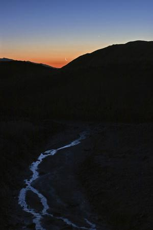 Mercury, Venus, and Crescent Moon Align in Morning Twilight over a Creek in the Great Salt Desert