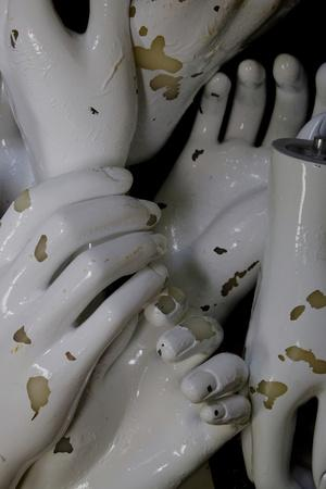 A Box Full of White Mannequin Hands in an Antique Shop