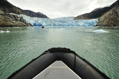 Tourists in an Inflatable Boat in Front of Dawes Glacier