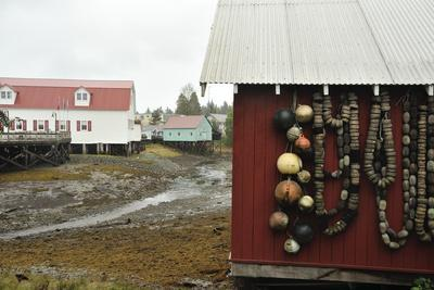 Fishing Floats Hang on the Side of a Red Building in the Town of Petersburg, Alaska