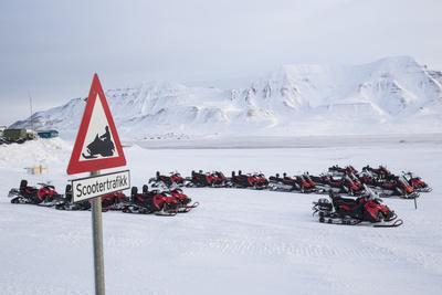 Snow Mobile Traffic Sign in Front of Snow Mobiles