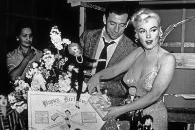 French Actor Yves Montand, American Actress Marilyn Monroe and a Birthday Cake