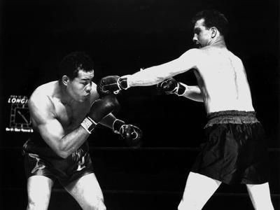 American Boxer Joe Louis (L) Fighting with Billy Conn 1946