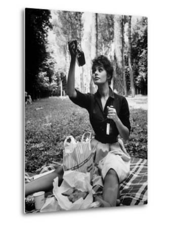 "Actress Sophia Loren Examining Contents of Bottle During Location Filming of ""Madame Sans Gene"""