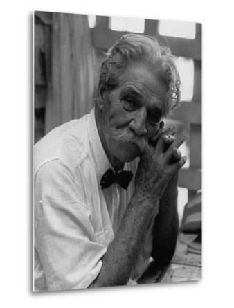 Dr. Albert Schweitzer, Medical Missionary and Humanitarian, Sitting in His Famous Hospital